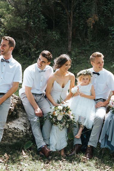 Wedding Party | Bride in Estelle Sally Eagle Gown | Flower Girl | Groomsmen in Grey Chinos & Navy Blazers | Outdoor Coastal Wedding at Ohawini Bay in New Zealand with Natural Garden Party Reception | Miss Gen Photography