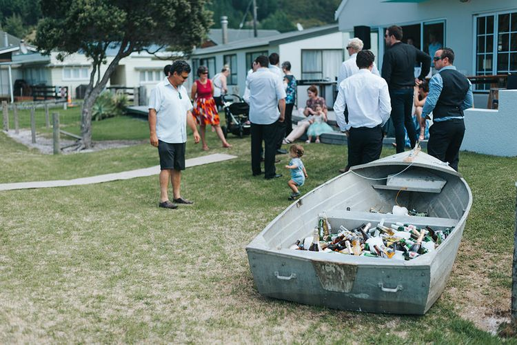 Beer Boat | Outdoor Coastal Wedding at Ohawini Bay in New Zealand with Natural Garden Party Reception | Miss Gen Photography