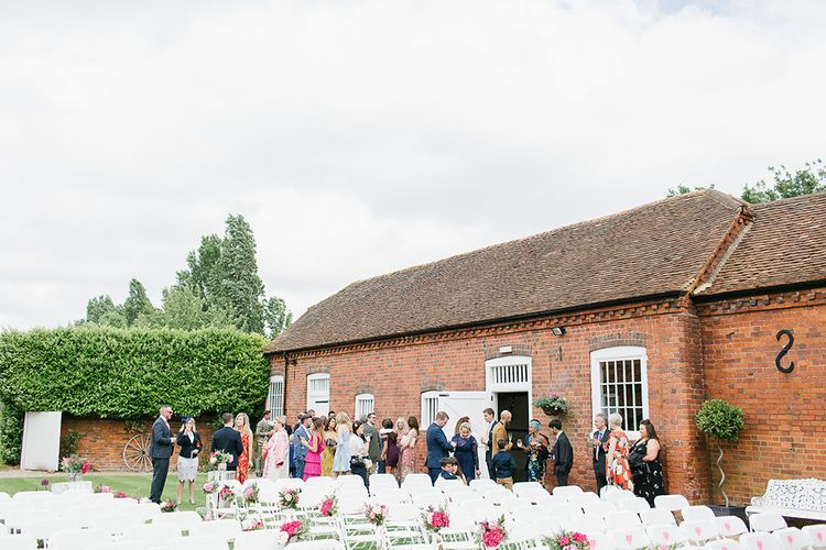 Lillibrooke Manor Wedding With Bright Pink Colour Scheme & Bride In Wtoo by Watters With Bridesmaids In Forest Green Images By Ilaria Petrucci Photography