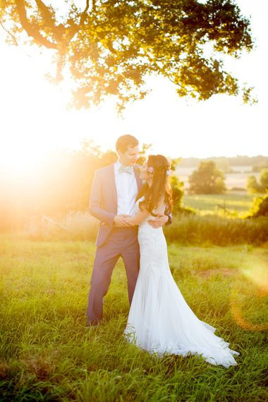 Bride in Pronovias Gown & Groom Navy in Kin by John Lewis Suit Sunset Moment