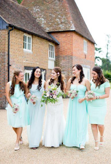Bride in Pronovias Gown and Bridesmaids in Mis-Match Aqua Dresses
