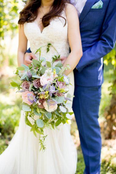 Romantic Darling & Wild Bouquet | Bride in Pronovias Gown & Groom Navy in Kin by John Lewis Suit