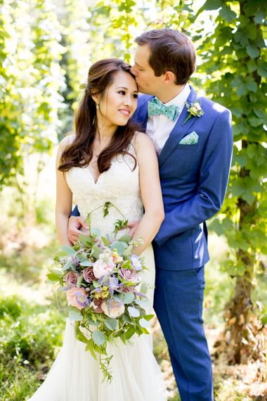 Bride in Pronovias Gown & Groom Navy in Kin by John Lewis Suit