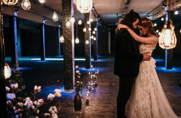 Bride in Lace Gown from Frock & Soul | White Rose & Cotton Bud Bouquet | Edison Lights | Industrial Wedding Inspiration at Victoria Warehouse in Manchester | Planning & Styling by The Urban Wedding Company | 2 Ducks Galleries