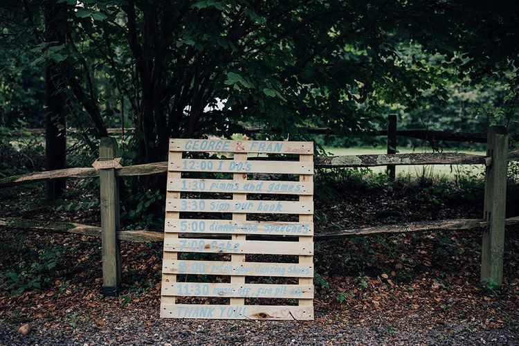 Wooden Palette Order of the Day Sign | DIY Woodland Wedding at Two Woods Estate in Sussex | PJ Phillips Photography