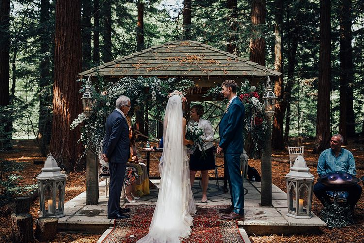 Wedding Ceremony | Bride in Bespoke Lace Gown & Flower Grown | Groom in Blue Suit | DIY Woodland Wedding at Two Woods Estate in Sussex | PJ Phillips Photography