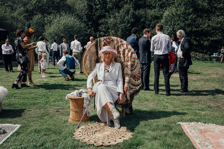 Wedding Guests in Peacock Chair | DIY Woodland Wedding at Two Woods Estate in Sussex | PJ Phillips Photography