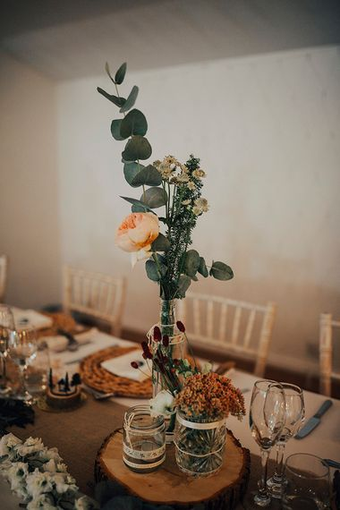 Rustic Centrepiece with Tree Slice & Flower Stems in Bottle & Jam Jars | DIY Woodland Wedding at Two Woods Estate in Sussex | PJ Phillips Photography