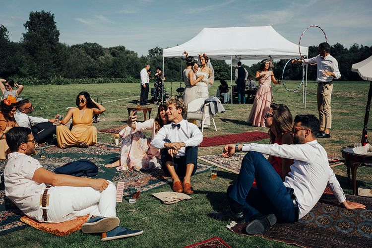 Relaxed Outdoor Reception with Moroccan Rugs | DIY Woodland Wedding at Two Woods Estate in Sussex | PJ Phillips Photography