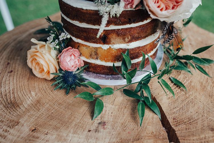 Naked Wedding Cake with David Austin Roses, Greenery & Feather Decor | DIY Woodland Wedding at Two Woods Estate in Sussex | PJ Phillips Photography