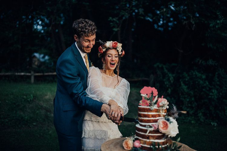 Cutting The Cake | Bride in Bespoke Lace Gown & Flower Grown | Groom in Blue Suit | DIY Woodland Wedding at Two Woods Estate in Sussex | PJ Phillips Photography