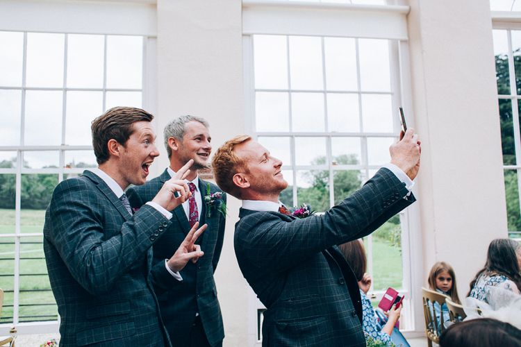 Wedding Ceremony | Groomsmen in Check Slaters Suits | Colourful Wedding at Kelmarsh Hall in Northamptonshire | Casey Avenue Photography
