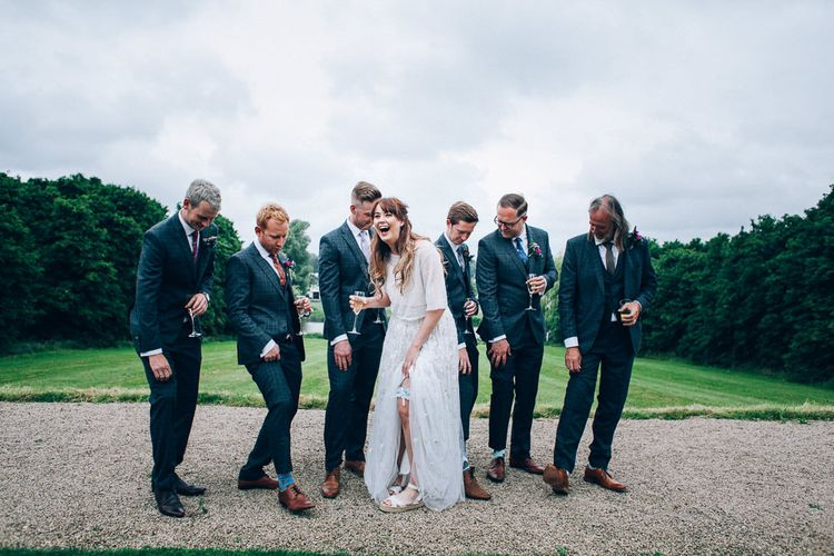 Bride in Needle & Thread Bridal Skirt | Groomsmen in Check Slaters Suits | Colourful Wedding at Kelmarsh Hall in Northamptonshire | Casey Avenue Photography