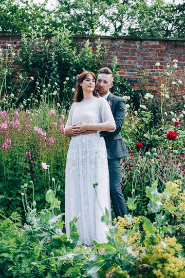 Bride in Needle & Thread Bridal Skirt | Groom in Check Slaters Suit | Colourful Wedding at Kelmarsh Hall in Northamptonshire | Casey Avenue Photography