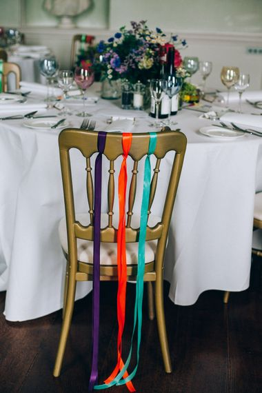 Colourful Ribbon Chair Back Decor | Colourful Wedding at Kelmarsh Hall in Northamptonshire | Casey Avenue Photography