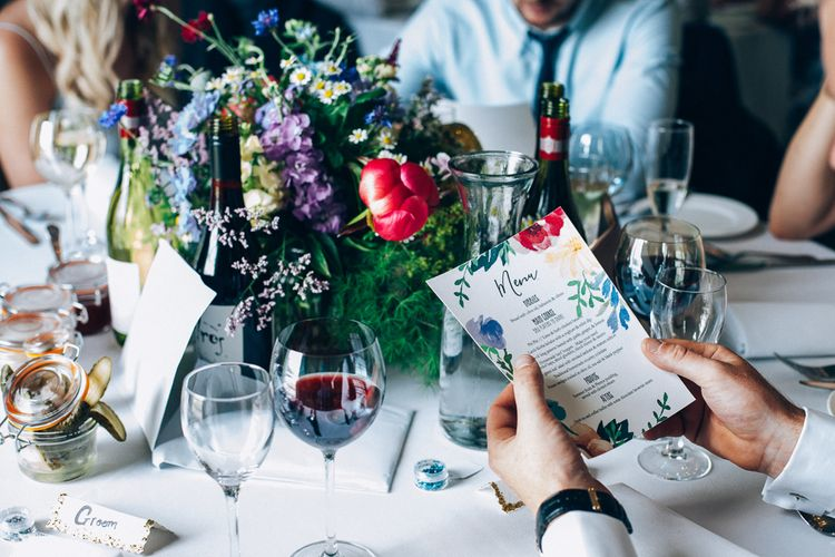 Colourful Menu Card & Floral Centrepiece | Colourful Wedding at Kelmarsh Hall in Northamptonshire | Casey Avenue Photography