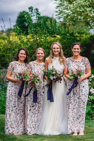 Bridal Party | Bridesmaids in Floral Miss Selfridge Maxi Dresses | Bride in Catherine Deane Carly Bridal Gown | Bright At Home Tipi Wedding | Barney Walters Photography