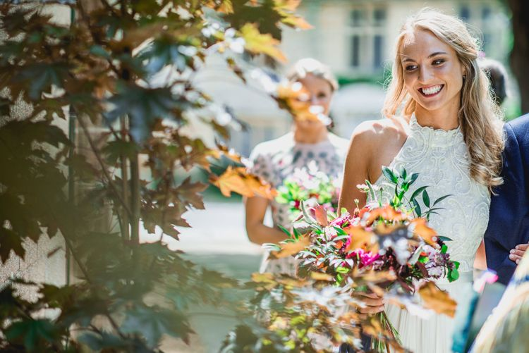 Bride in Catherine Deane Carly Bridal Gown | Bright At Home Tipi Wedding | Barney Walters Photography