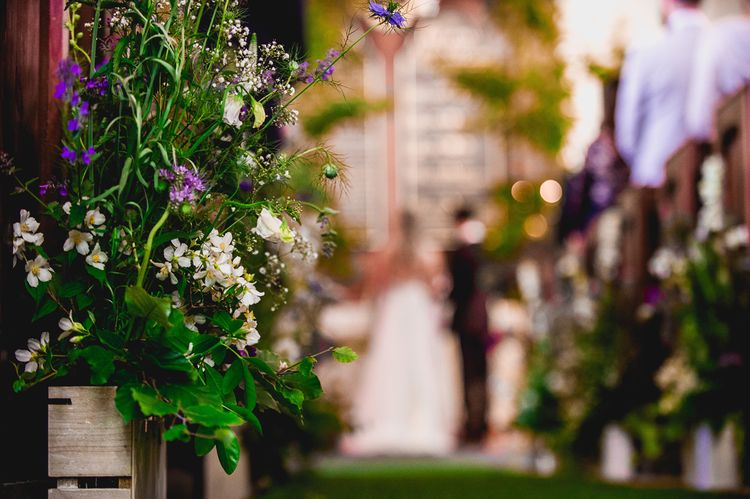 Church Aisle Flower Arrangements | Bright At Home Tipi Wedding | Barney Walters Photography
