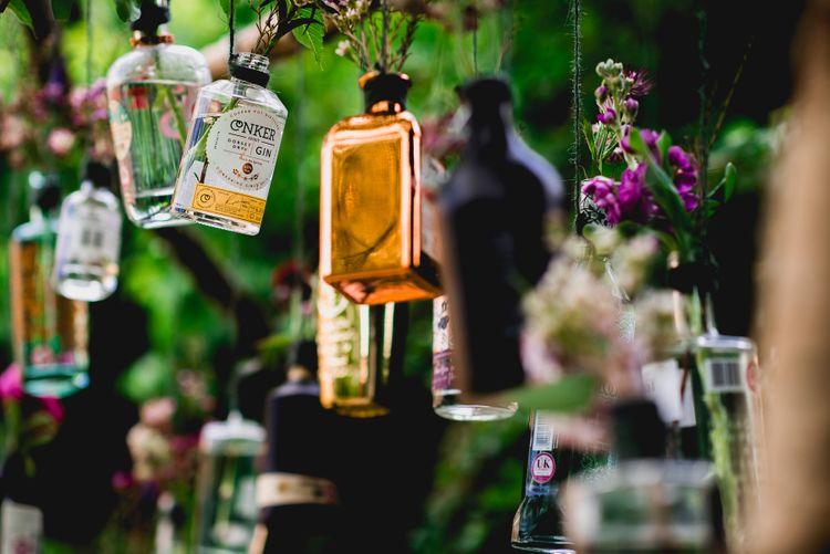 DIY Hanging Gin Bottles Wedding Decor | Bright At Home Tipi Wedding | Barney Walters Photography