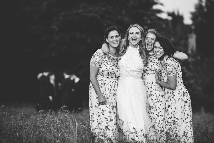Bridesmaids in Floral Miss Selfridge maxi Dresses | Bride in Catherine Deane Carly Bridal Gown | Bright At Home Tipi Wedding | Barney Walters Photography