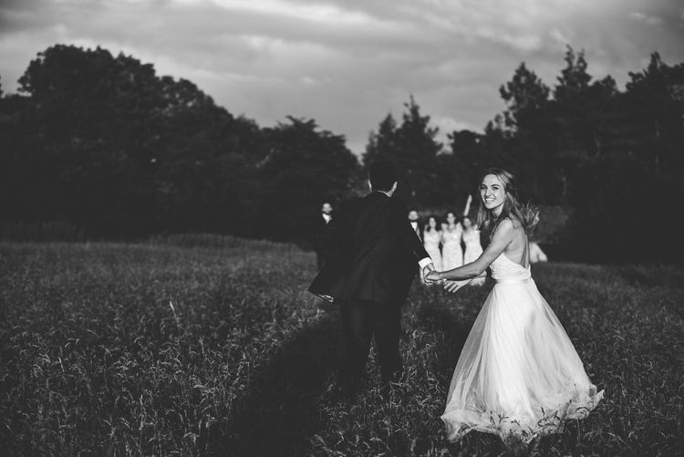 Bride in Catherine Deane Carly Bridal Gown | Groom in Navy Suit | Bright At Home Tipi Wedding | Barney Walters Photography