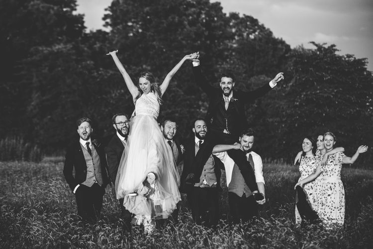 Wedding Party | Bride in Catherine Deane Carly Bridal Gown | Groom in Navy Suit | Bright At Home Tipi Wedding | Barney Walters Photography