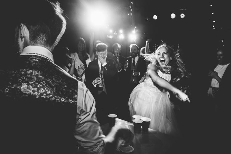 Beer Pong | Bride in Catherine Deane Carly Bridal Gown | Groom in Navy Suit | Bright At Home Tipi Wedding | Barney Walters Photography