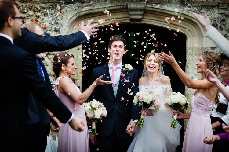 Confetti Exit | Bride in Sassi Holford Grace Wedding Dress | Groom in Traditional Oliver Brown Tailored Suit | Blink Photography