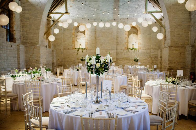 Hanging Lanterns and Floral Candelabra Centrepiece | Classic Pink Wedding at The Tithe Barn in Hampshire | Blink Photography
