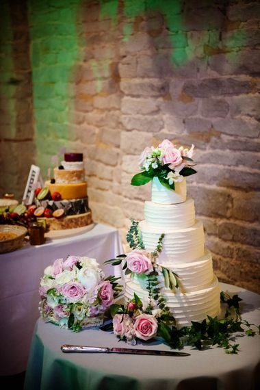 Frosting Wedding Cake | Classic Pink Wedding at The Tithe Barn in Hampshire | Blink Photography
