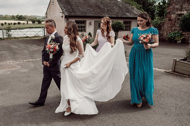 Bride in Justin Alexander and Bridesmaids in Different Coloured For Her and For Him Dresses