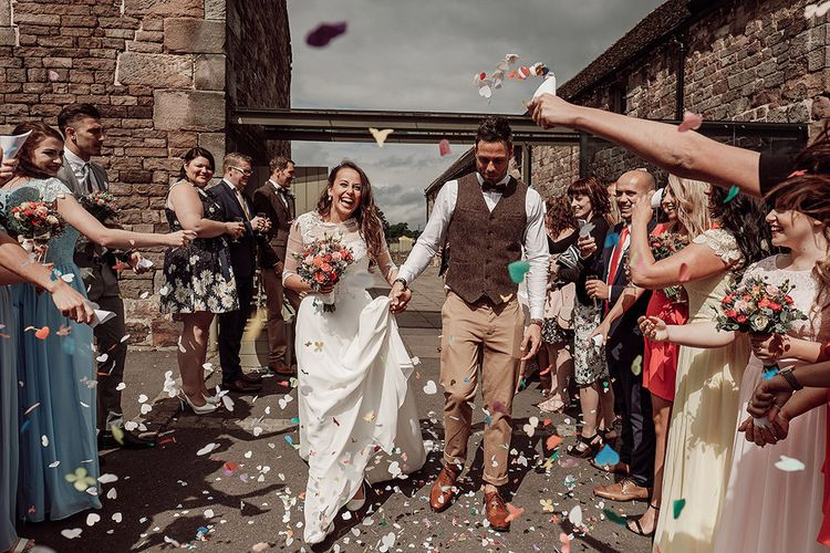 Bride in Justin Alexander and Groom in Chino's and Harris Tweed Confetti Moment