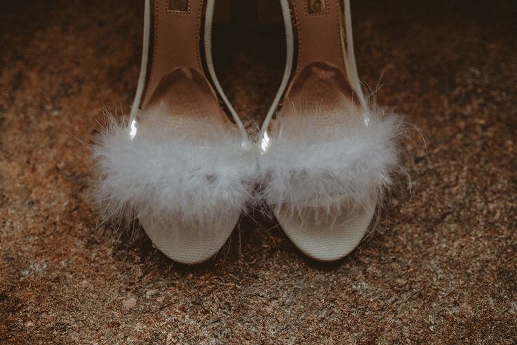 White Fluffy Bridal Shoes // Elegant White Wedding In Somerset With Bride In Lace Long Sleeved Gown With Open Back And Loose Braid With Hair Vine Images From Carla Blain Photography