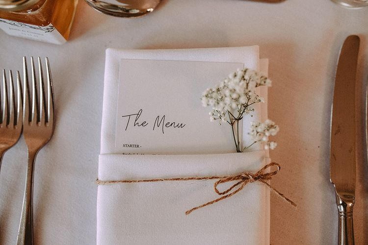 Elegant White Place Setting For Wedding With Baby's Breath // Elegant White Wedding In Somerset With Bride In Lace Long Sleeved Gown With Open Back And Loose Braid With Hair Vine Images From Carla Blain Photography