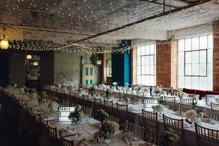 Relaxed Wedding Reception With Wooden Trestle Tables