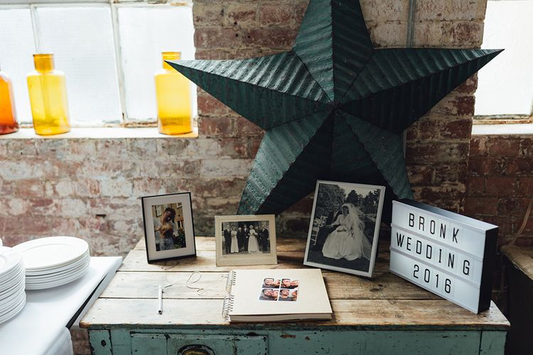Guest Book And Vintage Wedding Photographs At Wedding