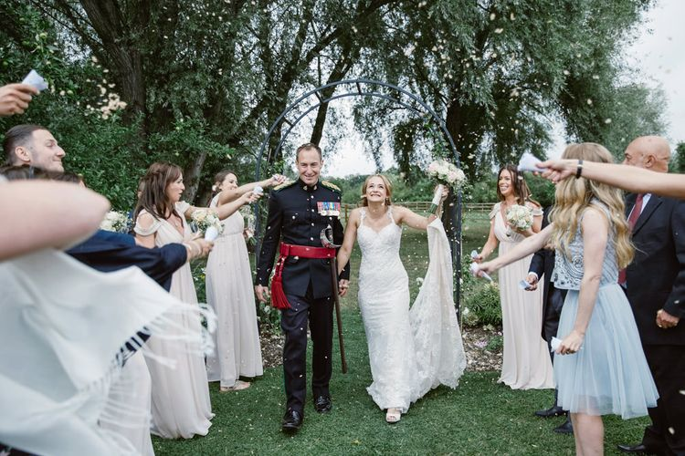 Confetti Moment   Bride in Naam Anat Bridal Gown   Groom in Military Uniform   Natalie J Weddings Photography