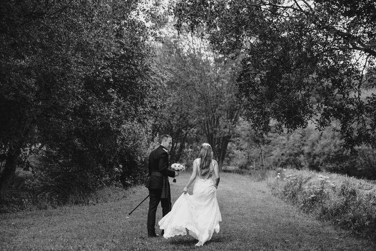 Bride in Naam Anat Bridal Gown   Groom in Military Uniform   Natalie J Weddings Photography