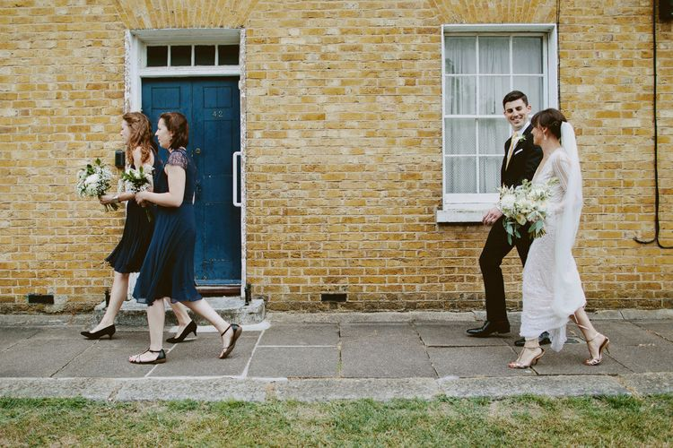 Bride in Preowned Lace Inbal Dror Wedding Dress | Bridesmaids in Different Navy Dresses | David Jenkins Photography