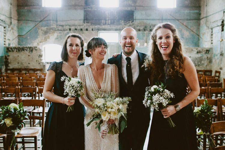 Bride in Preowned Lace Inbal Dror Wedding Dress | Bridesmaids in Different Navy Dresses | Groom in Gieves & Hawkes Suit | David Jenkins Photography