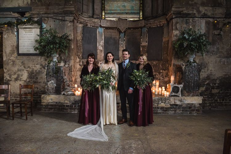 Bridesmaids in Burgundy BHLDN Gowns | Bride in Story of My Dress Bridal Gown | Groom in Navy Suit from Tom James Tailors | Vintage Wedding at The Asylum & Town hall Hotel London | Kevin Fern Photography