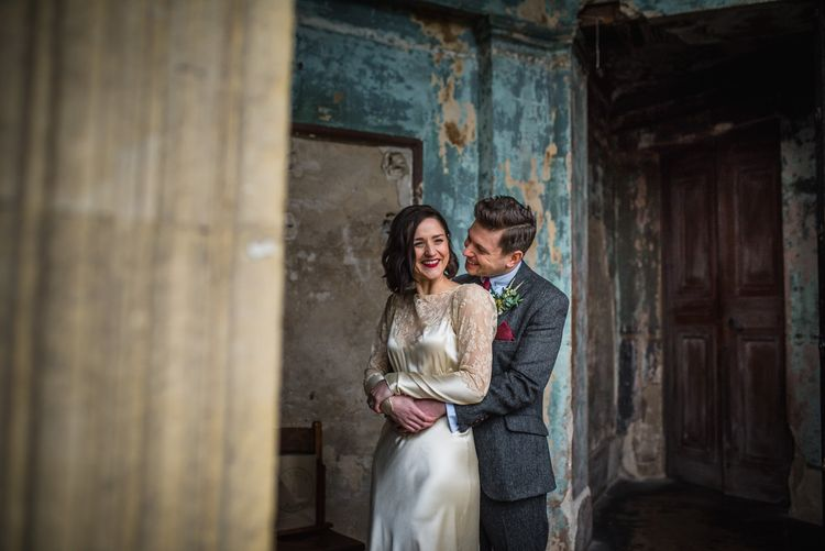 Bride in Story of My Dress Bridal Gown | Groom in Navy Suit from Tom James Tailors | Vintage Wedding at The Asylum & Town hall Hotel London | Kevin Fern Photography