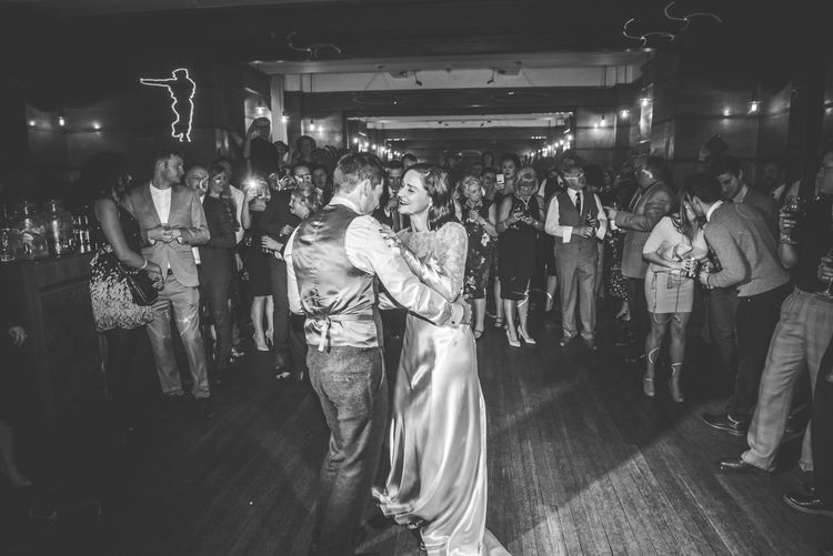 First Dance | Bride in Story of My Dress Bridal Gown | Groom in Navy Suit from Tom James Tailors | Vintage Wedding at The Asylum & Town hall Hotel London | Kevin Fern Photography