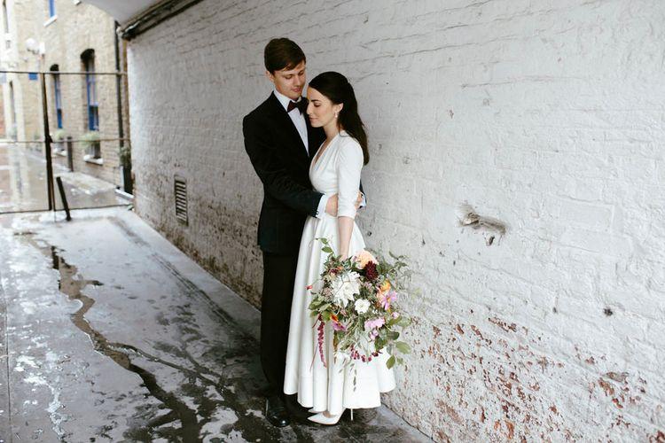 Elegant Bride in Delphine Manivet Prospere Wedding Dress & Groom in Velvet Jacket