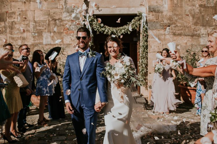 Confetti Exit | Bride in Morgan Davies Gown | Groom in Suit Supply | D&A Photography | Ben Walton Films