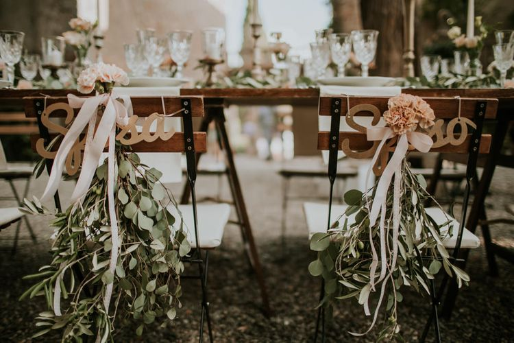 Elegant Chair Back Decor | Tuscan Wedding Planned by Romeo & Juliet Weddings | D&A Photography | Ben Walton Films