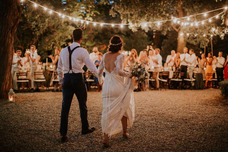 Festoon Lit Outdoor Reception | Bride in Morgan Davies Gown | Groom in Suit Supply | D&A Photography | Ben Walton Films