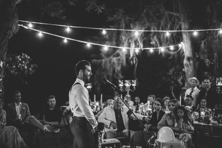 Wedding Speeches Under Festoon Lights | Bride in Morgan Davies Gown | Groom in Suit Supply | D&A Photography | Ben Walton Films