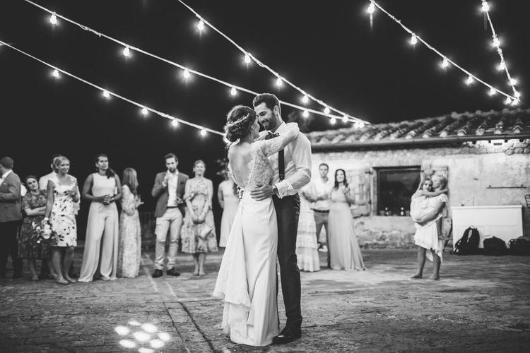 First Dance Under Festoon Lights | Bride in Morgan Davies Gown | Groom in Suit Supply | D&A Photography | Ben Walton Films